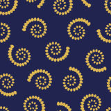 Yellow swirls on blue background seamless pattern Royalty Free Stock Photography
