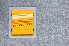 Yellow Swiss Window Shutter. S at an old building in rural Switzerland Royalty Free Stock Photos