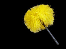 Yellow synthetic feather duster over black Stock Image
