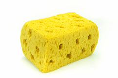 Yellow synthetic sponge on white background. Stock Photography