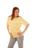 Yellow t shirt girl. Cute young woman in a yellow t shirt Royalty Free Stock Photo