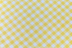 Yellow tablecloth. Orange and white gingham tablecloth pattern Stock Photography