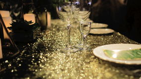 On Yellow Tablecloth Are Two Empty Glasses stock footage
