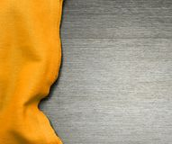 Yellow tablecloth on wooden table for background. Fabric texture. Wooden texture. Top view. Space for text. Stock Photo