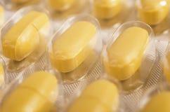 Yellow tablets closeup of Stock Photos