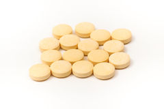 Yellow tablets with the white background Royalty Free Stock Image