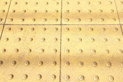 Yellow tactile strip Royalty Free Stock Photos