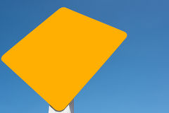 Yellow tag in blue sky background Royalty Free Stock Photography