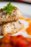 Yellow tail fillet dine. Yellow tail fillet, carrot puree and braised bak choy and tomato Royalty Free Stock Photo