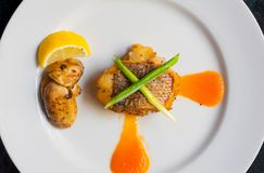 Yellow tail fillet dine. Yellow tail fillet, carrot puree and sauteed mushroom Royalty Free Stock Photography