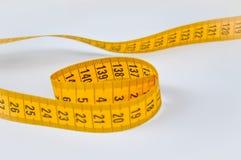 Yellow tailor meter Royalty Free Stock Photos