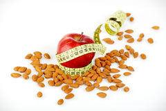Yellow tailoring meter and almonds Stock Photo