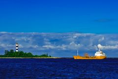 Yellow tanker ship. Yellow cargo tanker ship moving at the clear summer day Stock Images
