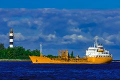 Yellow tanker ship. Yellow cargo tanker ship moving at the clear summer day Stock Photos