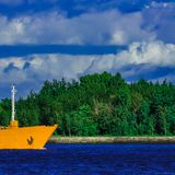 Yellow tanker ship. Yellow cargo tanker ship moving at the clear summer day Royalty Free Stock Images