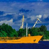 Yellow tanker ship. Yellow cargo tanker ship moving at the clear summer day Royalty Free Stock Photography