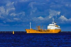 Yellow tanker ship. Yellow cargo tanker ship moving at the clear summer day Royalty Free Stock Photo