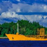 Yellow tanker ship. Yellow cargo tanker ship moving at the clear summer day Royalty Free Stock Photos
