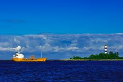 Yellow tanker ship. Yellow cargo tanker ship moving at the clear summer day Royalty Free Stock Image
