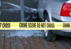 Yellow Tape Blocks a Crime Scene. Yellow tape is put up to mark a crime scene Stock Images