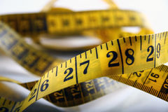 Yellow tape measure. Close up Stock Photography