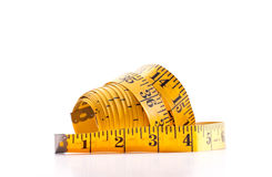 Yellow Tape Measure. Unrolled on white background for weight loss concept royalty free stock photo