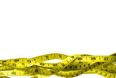 Yellow tape measure. Tangled, against white ground; excellent border; good copy space; clipping path included Stock Image