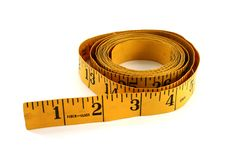 Yellow Tape Measure. Isolated on white royalty free stock image