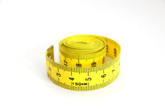 Yellow tape-measure Stock Images