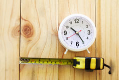 Yellow tape measure and clock Stock Image