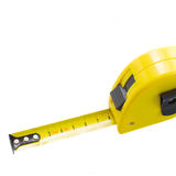 Yellow tape measure close up. Isolated on white background stock photography