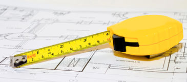 Yellow Tape Measure on Construction Drawing Royalty Free Stock Photo