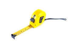 Yellow tape measure. Isolated on white background stock photo