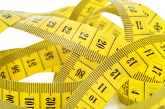 Yellow tape measure isolated on white. Stock Photography