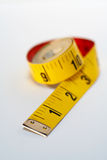 Yellow tape measure macro. On white background stock photography