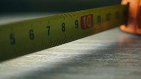 Yellow tape measure macro shot. Yellow tape measure macro video stock footage