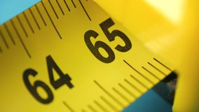 Yellow tape measure, roll of measuring tape. stock footage
