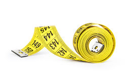 Yellow tape measure on rolled up on Royalty Free Stock Photography