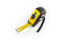 Yellow tape measure or steel tape isolated white background. Stock Photo