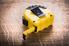 Yellow tape measure on wooden board construction Stock Images