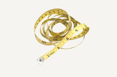 Yellow tape measuring. With white background Stock Photo