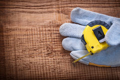 Yellow tapeline in protective glove on vintage Royalty Free Stock Image