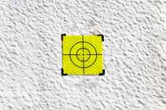 Yellow target point on white background Stock Images