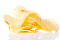 Yellow, tasty but unhealthy potatoe chips. Stock Photo