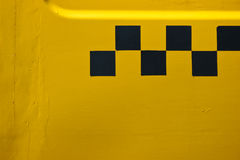 Yellow taxi. At the bus stop Royalty Free Stock Photo