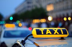 Yellow Taxi. Inscription with reflection Stock Photos
