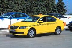 Yellow taxi at the airport Hrabrovo. KHRABROVO, RUSSIA — JULY 21, 2014: Yellow taxi at the airport Hrabrovo, Kaliningrad region Stock Photo