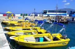 Yellow taxi boats Stock Photos