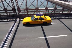 Yellow taxi on Brooklyn bridge Stock Photography