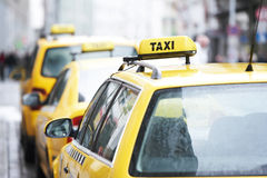 Yellow taxi cab cars. Waiting  for a client passenger in turn Stock Photos